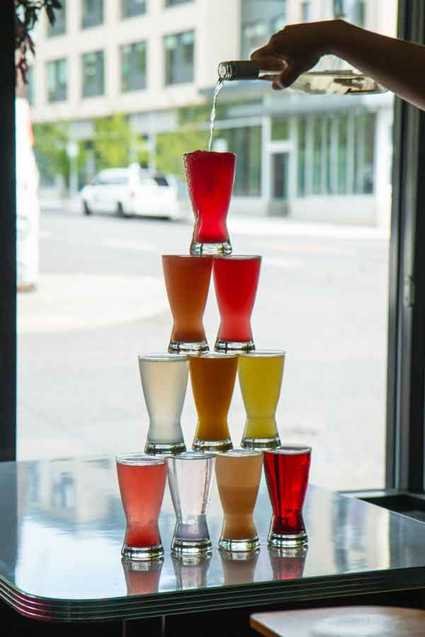 A tower of drinks being poured at Jam on Hawthorne.